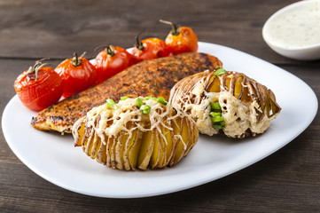 Fototapete - Baked potatoes with grilled chicken