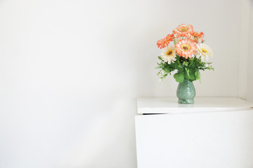 Flower bouquet on white table.