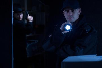 Policeman holding flashlight