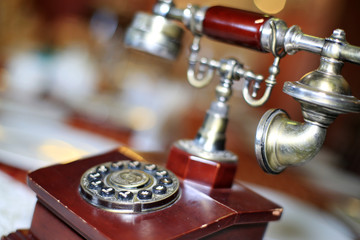 Retro telephone with wooden case and buttons