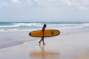 Young surfer. Kuta, Bali, Indonesia