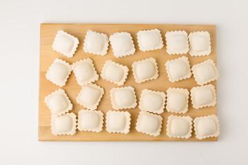 frozen a dumplings on a board