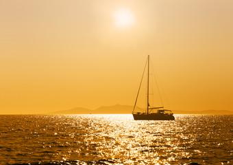 Sea, sunset, yacht.