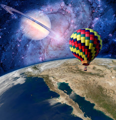 Hot air balloon fairy tale landscape fantasy saturn earth. Elements of this image furnished by NASA.