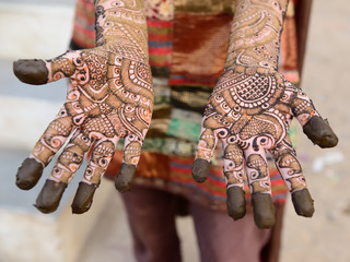 Hindu henna design on hands of women from India.