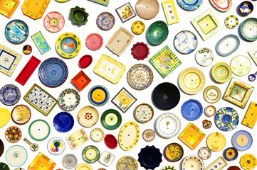 Colorful ceramic plates on the wall of the pottery store in Sagres, Portugal on June 07, 2015