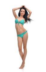 full body brunette woman posing in modern bikini swimsuite