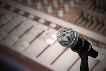 Microphone on sound mixer background