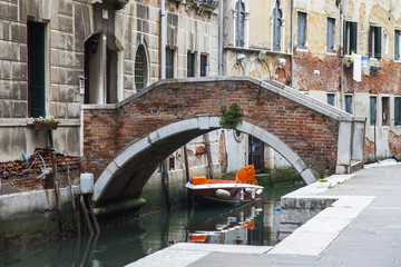 VENICE, ITALY. The bridge with steps through the street canal