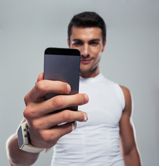 Fitness man making selfie photo on smartphone