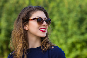 Portrait of a happy and beautiful young woman outdoors.