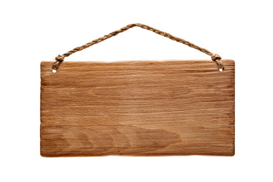 wooden signboard hanging from a rope