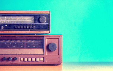 Old radios on blue background, filtered photo