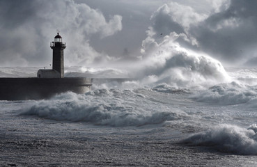 Storm waves over the Lighthouse, Portugal - enhanced sky Wall mural