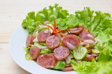 Chinese Sausage Salad on wood background