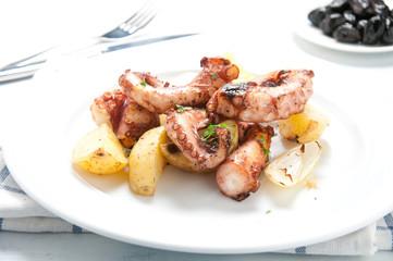 Polpo alla lagareiro a typical Portuguese dish with potatoes and onions