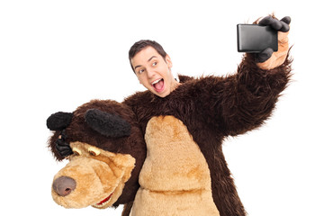 Man in a bear costume taking a selfie