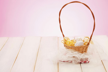 Easter eggs/Decorative eggs in basket on plaid cloth