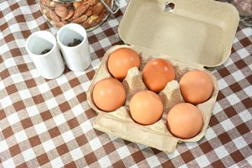 Close up eggs in cardboard box.