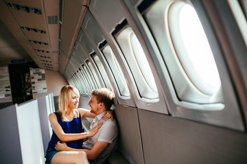 Young couple on board the aircraft