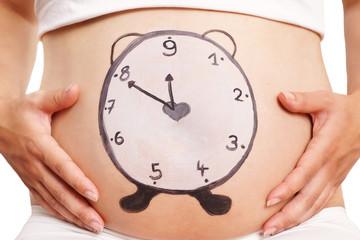 Babybauch mit Uhr