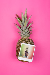 Pineapple with photograph of hipster pineapple