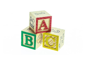 Close up ABC colorful alphabet blocks isolated on white