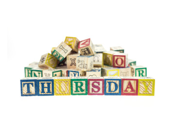 Thursday written in letter colorful alphabet blocks isolated on