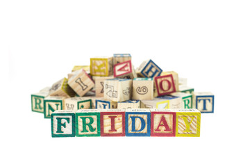 Friday written in letter colorful alphabet blocks isolated on wh