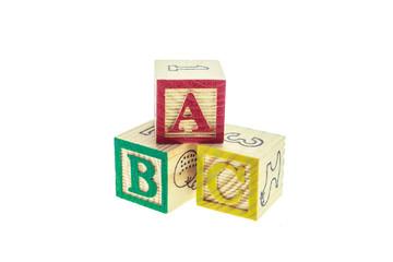 Close up ABC colorful alphabet blocks isolated on white