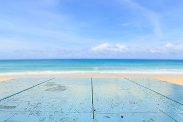 Top of wood table and view of tropical beach