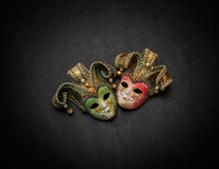 beautiful amazing closeup view of colorful theatrical masks on dark grey background