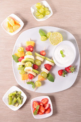 fruits on sticks and dip