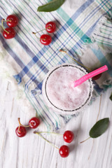 milkshake cherry in a glass. vertical top view