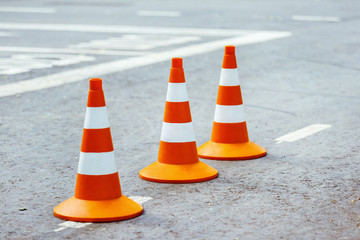 Closeup image of traffic  sign - orange cone with white stripes