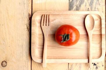 Fresh tomato on wood background