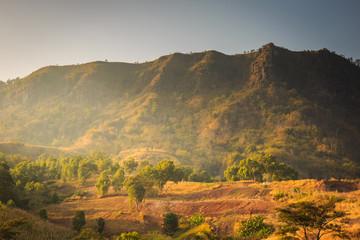 Autocollant pour porte Orange eclat Green rocky mountain in sunset time at Phutubberg Phetchabun, Thailand
