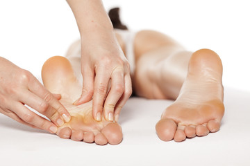 massaging the acupressure points on the female foot