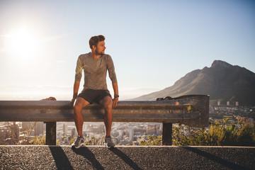 Man taking a break after morning run