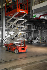 warehouse hall with hydraulic scissors lift