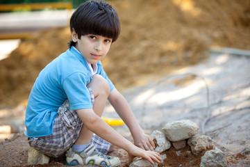 boy builds a house