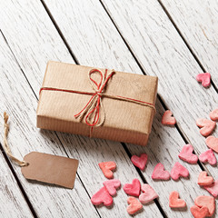 Gift box with blank gift tag and heap of hearts
