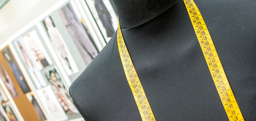 Dummy for tailor with a measure tape.