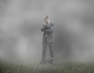 Sad and Tired Businessman in Misty Cloudy Background