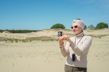 Woman remove a camera on vacation