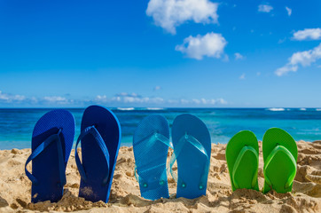 Colorful flip flops on the sandy beach
