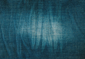 texture of blue jeans with pleats and scuffed