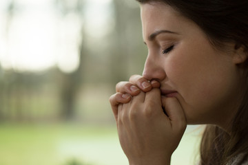 Depressed young woman crying