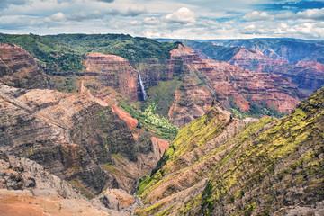 waipoo falls in the colorful Waimea canyon on the Island of Kauai, Hawaii