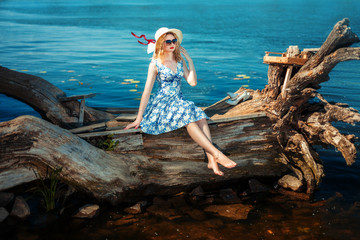 Girl sitting on a driftwood